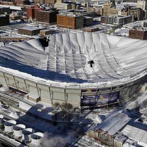 The powerful storm caused the Minneapolis Metrodome's inflatable Teflon roof to collapse (AP)