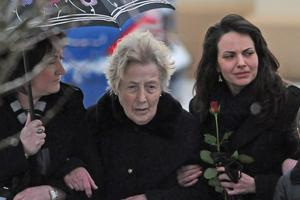 The funeral of Pat Cullinan, 45, who died in Thursday's plane crash. Among the mourners was his mother Rose and girlfriend Tina, right