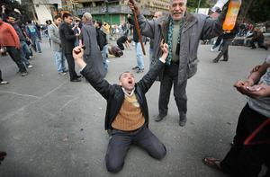 CAIRO, EGYPT - JANUARY 30:  People in Tahrir Square celebrate after hearing an incorrect rumour that President Hosni Mubarak had left the country on January 30, 2011 in Cairo, Egypt. Cairo remained in a state of flux and marchers continued to protest in the streets and defy curfew, demanding the resignation of Egyptian president Hosni Mubarek. As President Mubarak struggles to regain control after five days of protests he has appointed Omar Suleiman as vice-president. The present death toll stands at 100 and up to 2,000 people are thought to have been injured during the clashes which started last Tuesday. Overnight it was reported that thousands of inmates from the Wadi Naturn prison had escaped and that Egyptians were forming vigilante groups in order to protect their homes.   (Photo by Peter Macdiarmid/Getty Images)