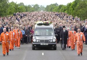 Thousands of fans attended motorbike ace Joey Dunlop's funeral today at Garryduff, Ballymoney. July 2000