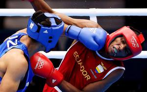 LONDON, ENGLAND - JULY 31:  Anderson Mina Rojas of Equador (R) in action with Uktamjon Rahmonov of Uzbekistan during the Men's Light Welter (64kg) Boxing on Day 4 of the London 2012 Olympic Games at ExCeL on July 31, 2012 in London, England.  (Photo by Scott Heavey/Getty Images) ***BESTPIX***