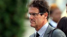 England manager Fabio Capello arrives at Heathrow Airport, London. The England team returned to the UK after a 4-1 defeat to Germany in the Round of 16 match in Bloemfontein, South Africa on Sunday
