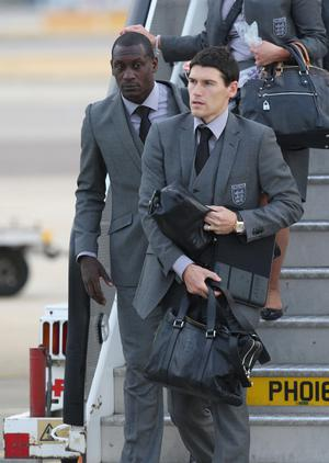 England's Gareth Barry and Emile Heskey arrive at Heathrow Airport, London. The England team returned to the UK after a 4-1 defeat to Germany in the Round of 16 match in Bloemfontein, South Africa on Sunday