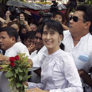 Aung San Suu Kyi arrives at the headquarters of her National League for Democracy party in Yangon (AP)