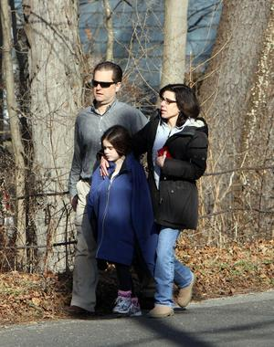Parents walk away from the Sandy Hook School with their children following a shooting at the school Friday, Dec. 14, 2012.  A man opened fire inside the Connecticut elementary school where his mother worked Friday, killing 26 people, including 18 children, and forcing students to cower in classrooms and then flee with the help of teachers and police. (AP Photo/The Journal News, Frank Becerra Jr.) MANDATORY CREDIT, NYC OUT, NO SALES, ONLINE OUT, TV OUT, NEWSDAY INTERNET OUT; MAGS OUT