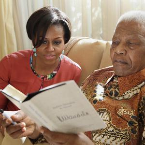 Michelle Obama with former South African President Nelson Mandela, at this home, in Houghton, South Africa(AP)