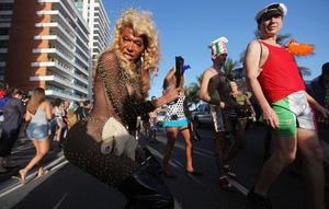 RIO DE JANEIRO, BRAZIL - FEBRUARY 18:  Brazilian revelers parade during Carnival celebrations along Ipanema beach on February 18, 2012 in Rio de Janiero, Brazil. Carnival is the grandest holiday in Brazil, annually drawing millions in raucous celebrations culminating on Fat Tuesday before the start of the Catholic season of Lent which begins on Ash Wednesday. Police strikes in Salvador and Rio de Janiero in recent weeks threatened Carnival and raised questions about the countryÄôs preparedness to host the upcoming 2014 World Cup and 2016 Summer Olympics.   (Photo by Mario Tama/Getty Images)