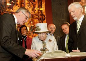 Queen Elizabeth II  and Prince Philip, Duke of Edinburgh are shown the Book of Kells during a visit to Trinity College Dublin on May 17