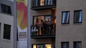 26.08.10. Picture by David Fitzgerald. Major Lazer performing at Belsonic Festival in Custom House Square, Belfast, last night. People stand on their balcony and watch the performance