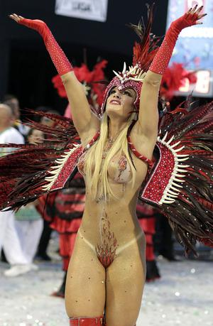 EDS NOTE NUDITY - A dancer performs during the parade of  Mancha Verde samba school in Sao Paulo, Brazil, Saturday, Feb. 18, 2012. (AP Photo/Andre Penner)