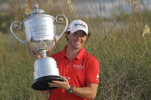 Rory McIlroy of Northern Ireland poses for photographers with the championship trophy after the final round of the PGA Championship golf tournament on the Ocean Course of the Kiawah Island Golf Resort in Kiawah Island, S.C., Sunday, Aug. 12, 2012.(AP Photo/John Raoux)