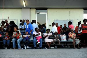 In this Jan. 17, 2010 photo released by the U.S. Air Force, U.S. citizens wait to be evacuated from Toussaint Louverture International Airport in Port-au-Prince, Haiti after a major earthquake devastated the area on Jan. 12.