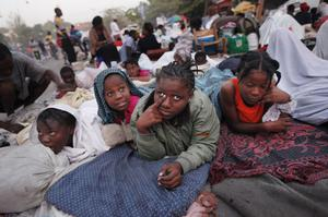 Displaced Haitians whose homes were either destroyed or too unsafe to return to, wake up on the street in the aftermath of Tuesday's earthquake in Port-au-Prince, Haiti, Monday, Jan. 18, 2010. Survivors live outside for fear of unstable buildings and aftershocks. (AP Photo/Gerald Herbert)
