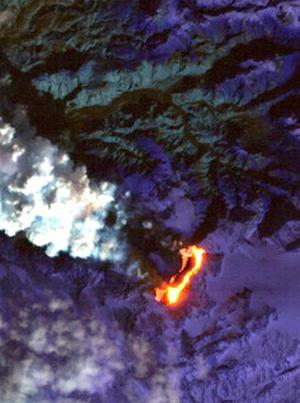This false-color short-wavelength infrared image shows Iceland's Eyjafjallajokull volcano (centre) from data obtained by NASA