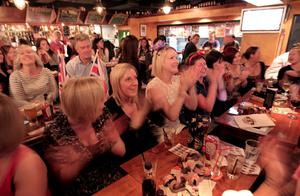 TOKYO, JAPAN - APRIL 29:  Tokyo expats watch the Royal Wedding of Prince William and Kate Middleton live on TV in the Hobgoblin British Pub in Shibuya on April 29, 2011 in Tokyo, Japan.  The wedding of Britain's Prince William and his fiancee Kate Middleton will be celebrated at Westminster Abbey in London on April 29, 2011. (Photo by Adam Pretty/Getty Images)