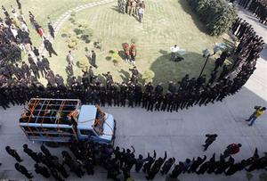 National Security Guard commandoes carry the coffin of commando Gajendra Singh, in New Delhi, India, Saturday, Nov. 29, 2008. Indian commandos killed the last remaining gunmen holed up at a luxury Mumbai hotel Saturday, ending a 60-hour rampage through India's financial capital by suspected Islamic militants that killed people and rocked the nation. (AP Photo/Mustafa Quraishi)
