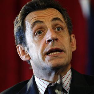 Nicolas Sarkozy was almost knocked to the ground after a bystander grabbed him during a visit to a town in southern France