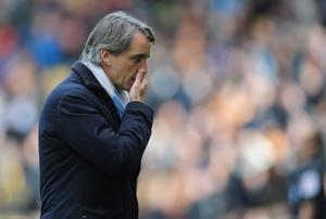 WOLVERHAMPTON, ENGLAND - APRIL 22:  Roberto Mancini of Manchester United looks on during the Barclays Premier League match between Wolverhampton Wanderers and Manchester City at Molineux on April 22, 2012 in Wolverhampton, England.  (Photo by Jamie McDonald/Getty Images)