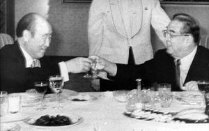 In this photo distributed on Dec. 7, 1991, Rev. Sun Myung Moon, left, toasts with North Korean founder Kim Il Sung in North Korea. Moon, the self-proclaimed messiah who founded the Unification Church, died Monday, Sept. 3, 2012 at a church-owned hospital near his home in Gapyeong County, northeast of Seoul, church officials said. He was 92. (AP Photo/Yonhap) KOREA OUT