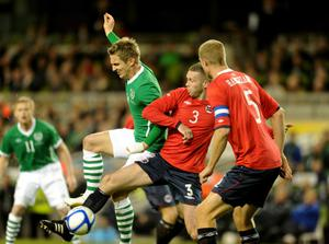 Ireland's Kevin Doyle battles with Norway's Kjetil Vaehler during the International Friendly at the AVIVA Stadium, Dublin, Ireland. PRESS ASSOCIATION Photo. Picture date: Wednesday November 17, 2010. See PA story SOCCER Republic. Photo credit should read: Barry Cronin/PA Wire.