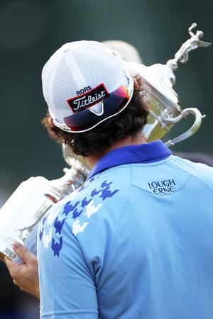 BETHESDA, MD - JUNE 19:  Rory McIlroy of Northern Ireland kisses the trophy after his eight-stroke victory on the 18th green during the 111th U.S. Open at Congressional Country Club on June 19, 2011 in Bethesda, Maryland.  (Photo by Jamie Squire/Getty Images)