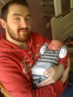 "Daithi McKay and his new son Ruadhan <p><b>To send us your Baby Pics <a href=""http://www.belfasttelegraph.co.uk/usersubmission/the-belfast-telegraph-wants-to-hear-from-you-13927437.html"" title=""Click here to send your pics to Belfast Telegraph"">Click here</a> </a></p></b>"