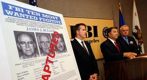 """LOS ANGELES, CA - JUNE 23:  Steven Martinez, (C) FBI assistant director in charge in Los Angeles, Douglas Price, (L) FBI Assistant Special Agent in Charge, and LAPD Deputy Chief,David Doan, Chief of Detectives, during a news conference to discuss the arrest of Boston crime boss James """"Whitey'' Bulger and his companion, Catherine Greig at the Los Angeles Federal Building on June 23, 2011 in Los Angeles, California.  The FBI announced June 23, 2011 that Bulger was captured in his home in Santa Monica, California by the FBI after a 26-year manhunt when a tip lead law enforcement to the reputed mobster.  (Photo by Kevork Djansezian/Getty Images)"""