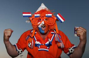 KHARKOV, UKRAINE - JUNE 13:  A Netherlands fan enjoys the atmosphere prior to the UEFA EURO 2012 group B match between Netherlands and Germany at Metalist Stadium on June 13, 2012 in Kharkov, Ukraine.  (Photo by Julian Finney/Getty Images)