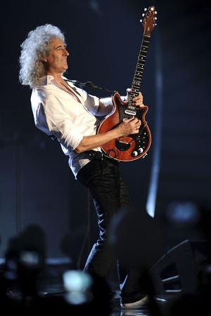 BELFAST, NORTHERN IRELAND - NOVEMBER 06:  Brian May of Queen performs onstage during the MTV Europe Music Awards 2011 live show at the Odyssey Arena on November 6, 2011 in Belfast, Northern Ireland.  (Photo by Ian Gavan/Getty Images)