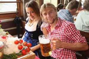 MUNICH, GERMANY - OCTOBER 07:  Anatoliy Tymoshchuk of FC Bayern Muenchen attends with Nadiya the Oktoberfest beer festival at the Kaefer Wiesnschaenke tent on October 7, 2012 in Munich, Germany.  (Photo by Thomas Niedermueller/Bongarts/Getty Images)