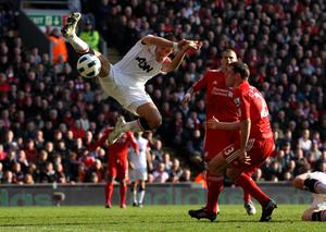 LIVERPOOL, UNITED KINGDOM - MARCH 06:  Javier Hernandez of Manchester United competes with Jamie Carragher of Liverpool during the Barclays Premier League match between Liverpool and Manchester United at Anfield on March 6, 2011 in Liverpool, England. (Photo by Alex Livesey/Getty Images)