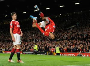 Michael Carrick watches as Nani celebrates his controversial goal against Spurs