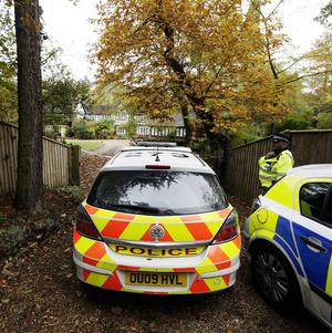 Police officers at Tun Cottage in Ascot, where they were hunting for Joanne Brown