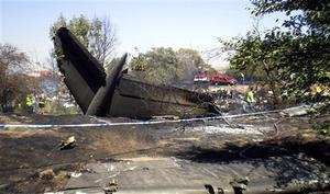 The tail of the Spanair jet that crashed on take off at Madrid airport is seen on Wednesday, Aug. 20, 2008