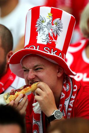 WARSAW, POLAND - JUNE 08:  A Poland fan eats ahead of the UEFA EURO 2012 group A match between Poland and Greece at The National Stadium on June 8, 2012 in Warsaw, Poland.  (Photo by Alex Grimm/Getty Images)