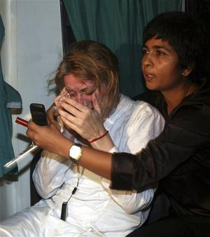 A foreign tourist breaks down after being rescued safely from a hotel following an attack in Mumbai in Mumbai, India, Wednesday night, Nov. 26, 2008. Teams of heavily armed gunmen stormed luxury hotels, a popular restaurant, hospitals and a crowded train station in coordinated attacks across India's financial capital Wednesday night, killing at least 78 people and taking Westerners hostage, police said. (AP Photo)