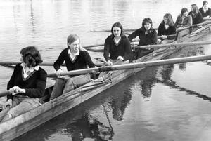 Boys are no longer having it all their own way and ripples are beginning to appear on the quiet waters of school rowing scene. The masculine superiority in the sport in now being challenged by the recently formed girls' rowing club at Methodist College Belfast. It is the only school girls' club in Northern Ireland. Here the trailblazing eight sets off from the school's boathouse at Stranmillis for an afternoon's rowing on the Lagan, 1971.