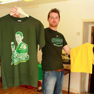 Billy Hayes with Barack Obama T-shirts in his shop in Moneygall, Co Offaly