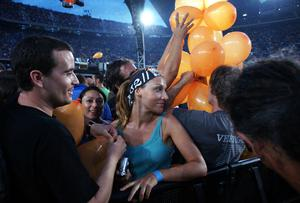 Fans of U2 watch them perform onstage on the first night of their 360 tour held at Camp Nou on June 30, 2009 in Ba2rcelona, Spain