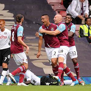 Winston Reid, centre, was on target with the second goal as West Ham defeated Fulham