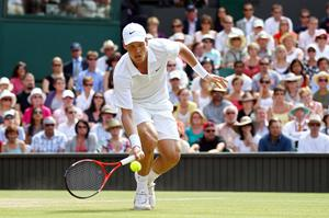 Tomas Berdych of Czech Republic plays a shot during his Quarter Final match against Roger Federer of Switzerland on Day Nine of the Wimbledon Lawn Tennis Championships