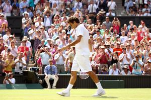 Roger Federer of Switzerland exits after losing his Quarter Final match against Tomas Berdych of Czech Republic on Day Nine of the Wimbledon Lawn Tennis Championships