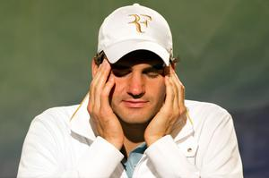 Roger Federer of Switzerland speaks during a press conference on Day Nine of the Wimbledon Lawn Tennis Championships