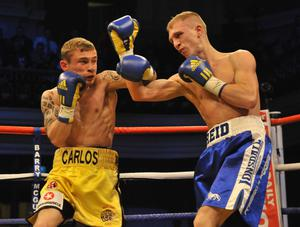 Carl Frampton won the Celtic super-bantamweight title at the Ulster Hall on Friday night against Gavin Reid.