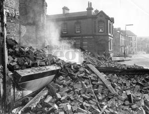 Riots : Belfast. August 1969.  Smoke still coming from the rubble of a building at the corner of Percy Street and Falls Road, Belfast, destroyed during the rioting.  (19/8/69)