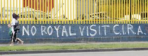 People walk past graffiti in Dublin city centre, ahead of the royal visit by  Queen Elizabeth II