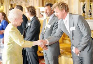 06/05/08f Britain's Queen Elizabeth II receiving celebrity chef Gordon Ramsay during a reception at Buckingham Palace in London. PRESS ASSOCIATION Photo.