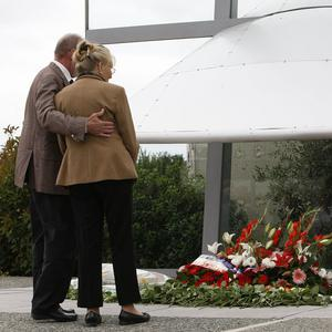 Families of victims from the Concorde jet crash gather at the site of the crash in Gonesse, north of Paris (AP)