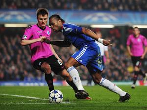 LONDON, UNITED KINGDOM - MARCH 16:  Didier Drogba (R) of Chelsea takes on William Kvist (L) of FC Copenhagen during the UEFA Champions League round of sixteen second leg match between Chelsea and FC Copenhagen at Stamford Bridge on March 16, 2011 in London, England.  (Photo by Shaun Botterill/Getty Images)