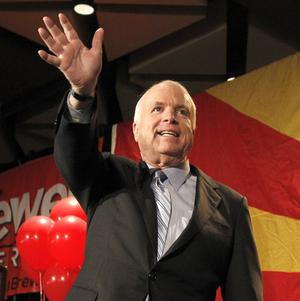 Republican John McCain waves to hundreds of supporters before speaking at an election night party in Phoenix